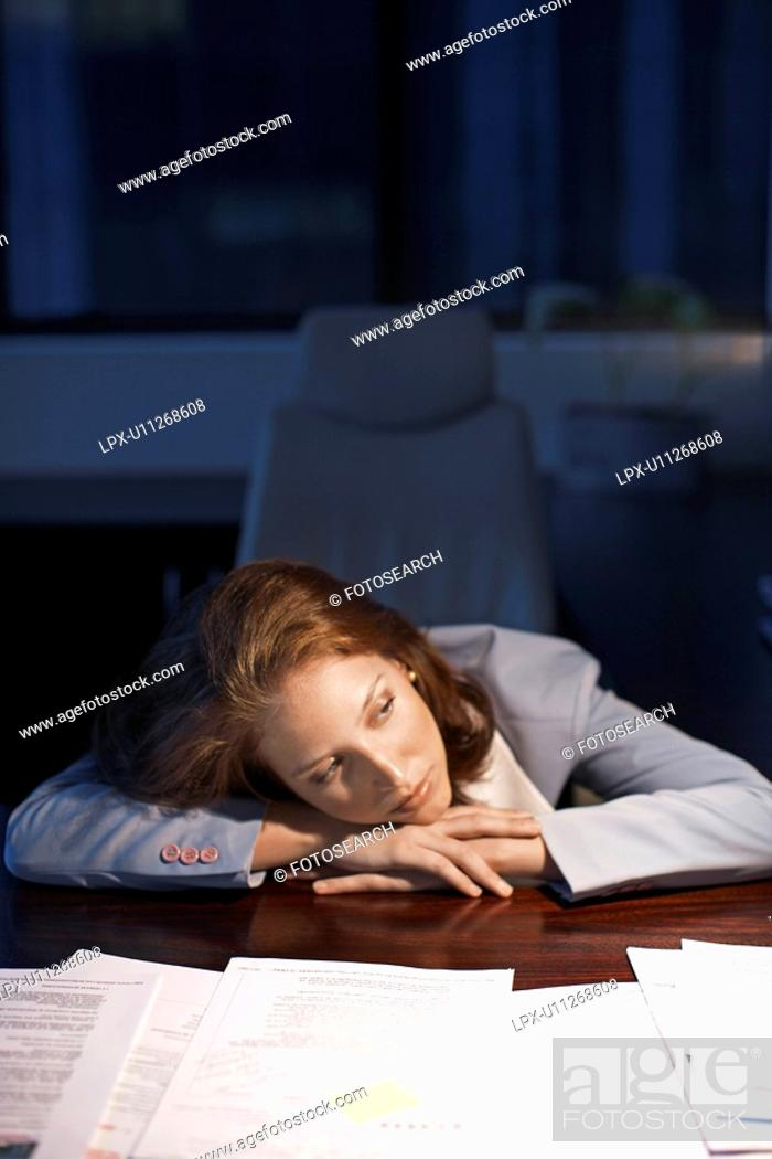 Stock Photo: Young Woman Working Late.