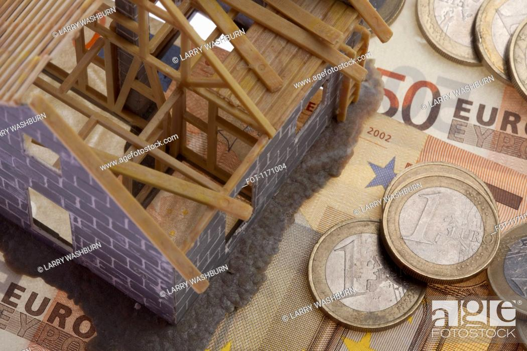 Stock Photo: A partially constructed miniature model of a house standing on top of European Union currency.