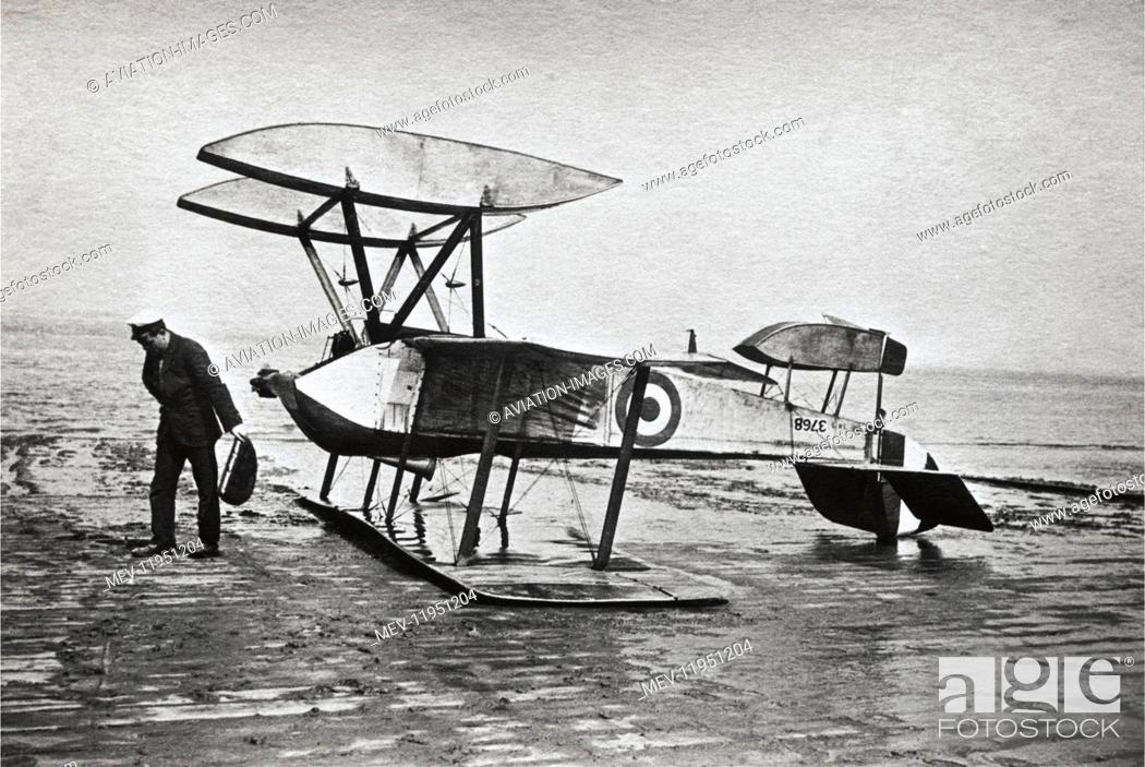 Stock Photo: Man Standing Beside a Crashed Royal Flying Corp Sopwith Schneider.