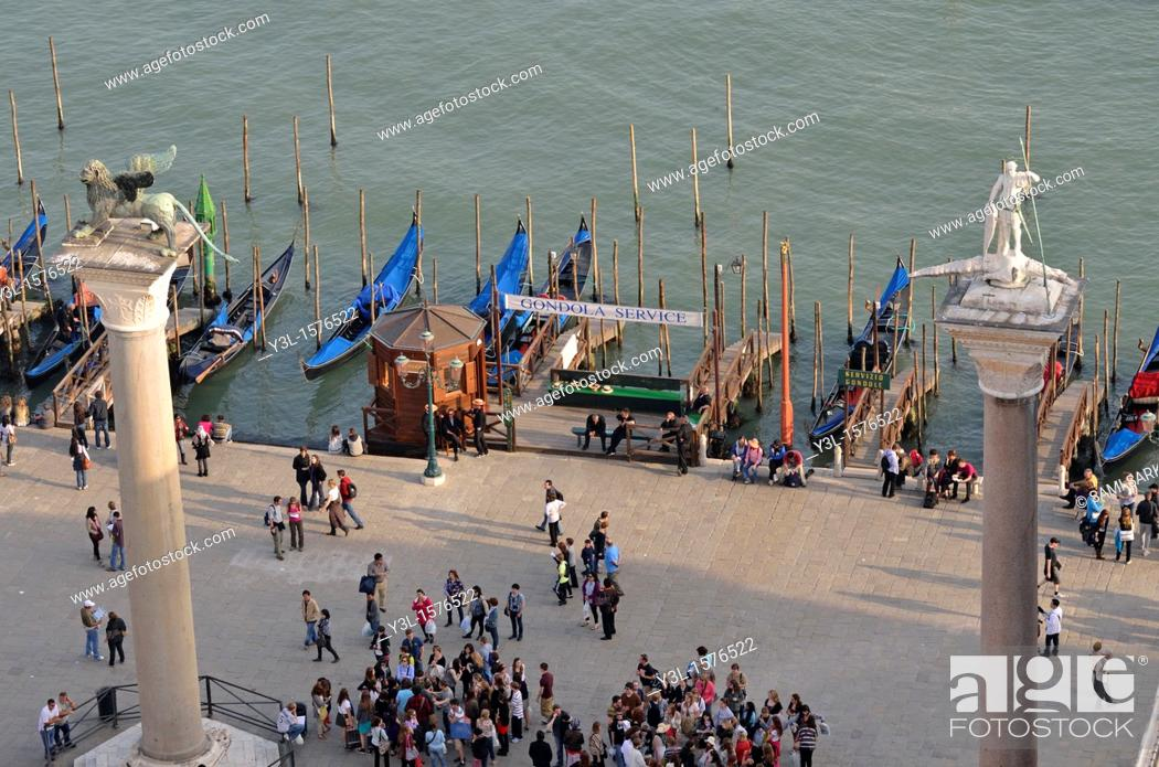 Stock Photo: Columns of San Marco left and San Teodoro right by gondolas harbor, elevated view from the Campanile, Venice, Italy.