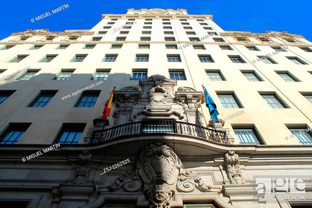 Stock Photo: Low-angle shot of Telefónica Building in Madrid's Gran Vía street, the first skyscraper built in Spain and in the whole Europe (1929) and designed by Ignacio de.