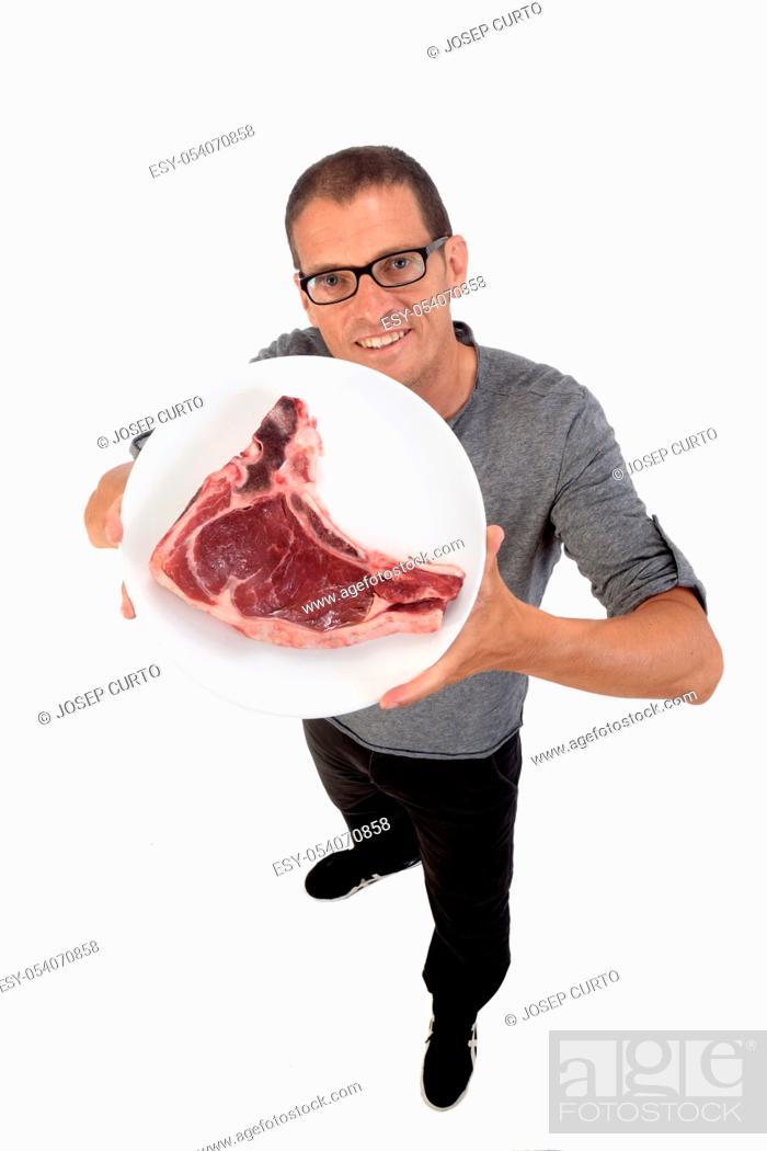 Stock Photo: man with entrecote on white background.
