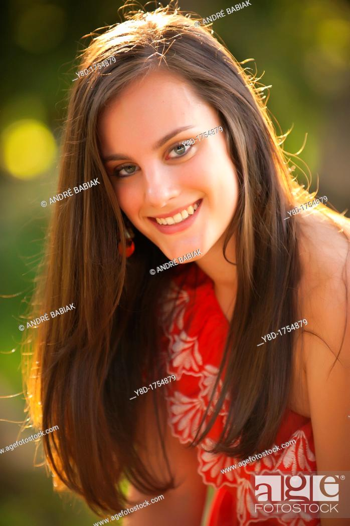 Stock Photo: Outdoor portrait of young woman with brunette hair, 17 years old caucasian.