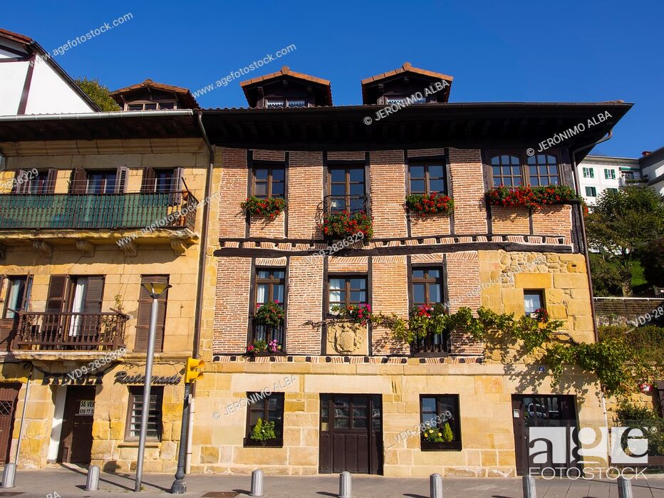 Stock Photo: Typical house and balcony with flowers. Pasai Donibane. Fishing village of Pasajes de San Juan. San Sebastian, Bay of Biscay, province of Gipuzkoa.