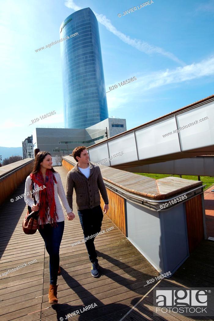 Stock Photo: Young couple walking, Iberdrola Tower, Padre Arrupe Bridge, Abandoibarra, Bilbao, Bizkaia, Basque Country, Spain.