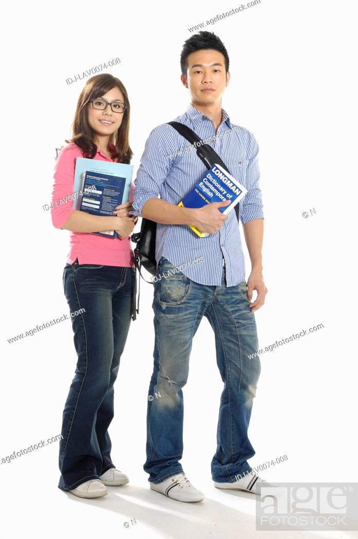 Stock Photo: University students standing together with books.