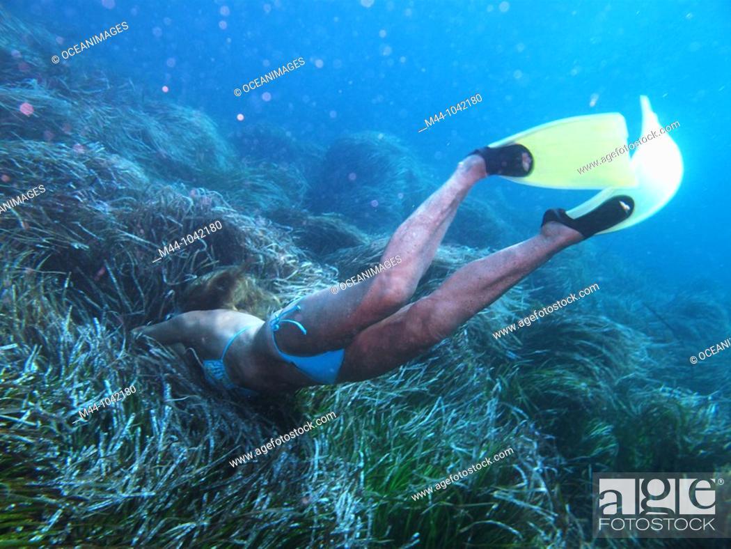 Stock Photo: Woman underwater.