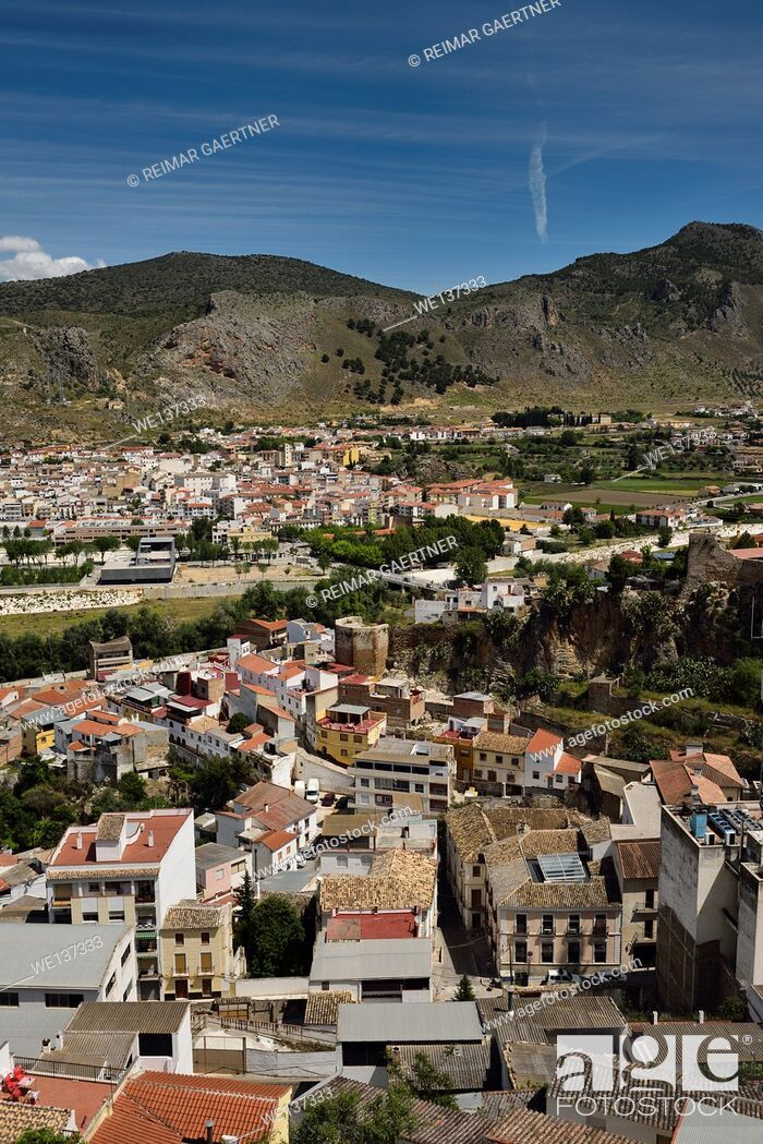 Stock Photo: View of modern movie theatre and ancient Alcazaba wall and tower in Loja Granada Spain.