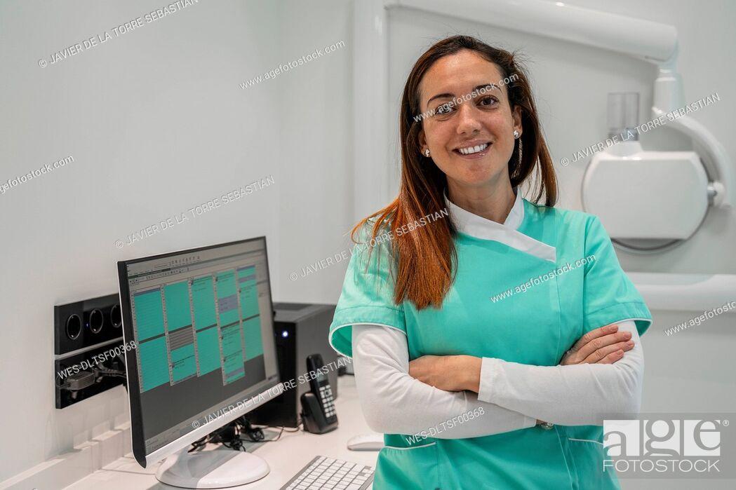 Stock Photo: Female dentist working in dental clinic.