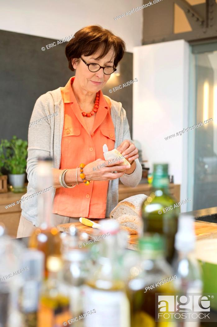 Stock Photo: Woman working in the kitchen.