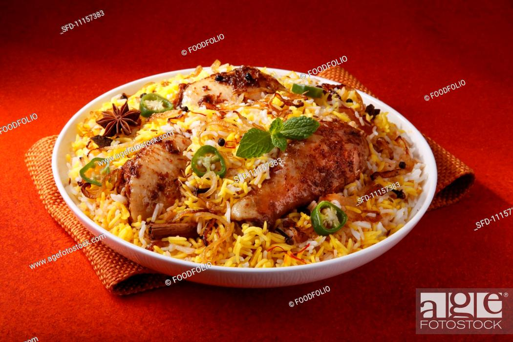 Chicken biryani with rice and spices (India), Stock Photo