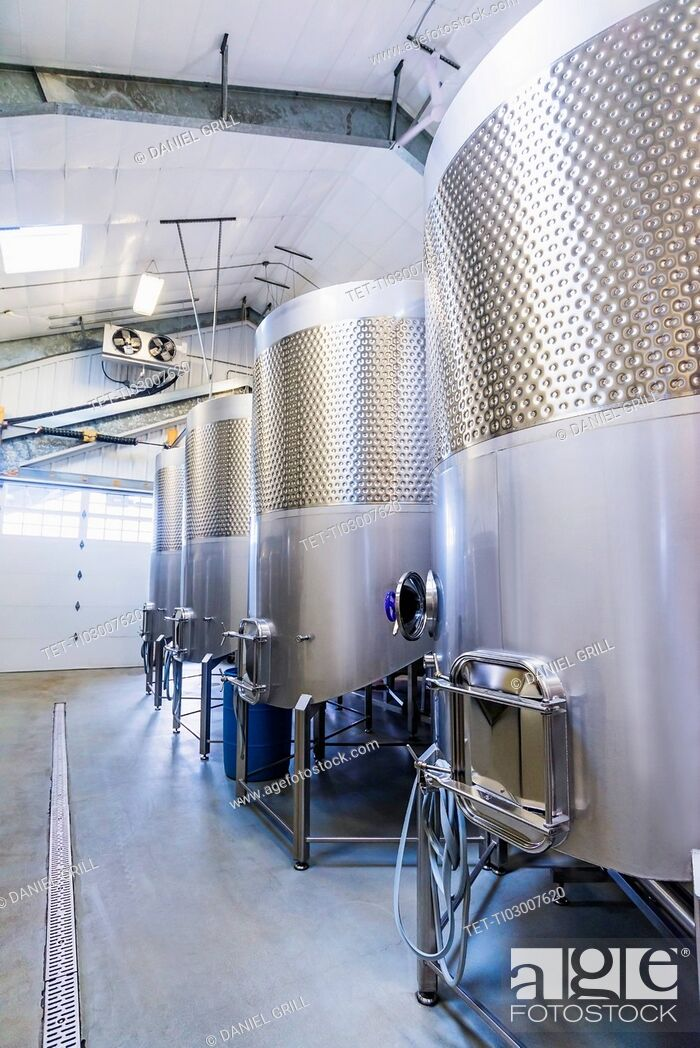 Stock Photo: Stainless steel tanks in winery cellar.