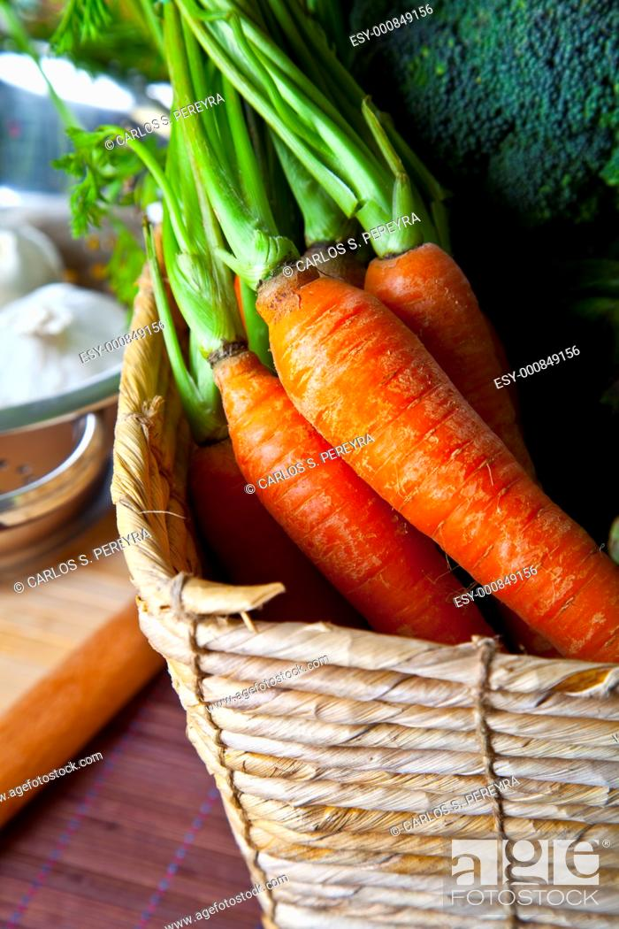 Stock Photo: organic carrots in a rustic basket.