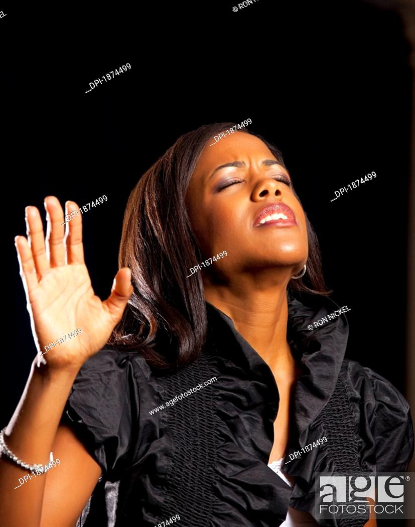 Stock Photo: Fort Lauderdale, Florida, United States Of America, A Woman Singing In Worship.