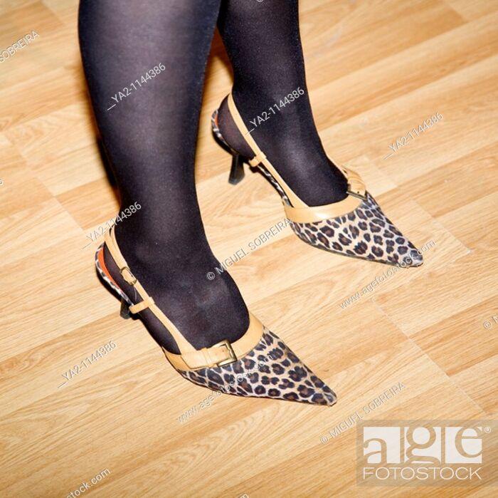 Stock Photo: Woman wearing high heeled leopard skin stilettos.