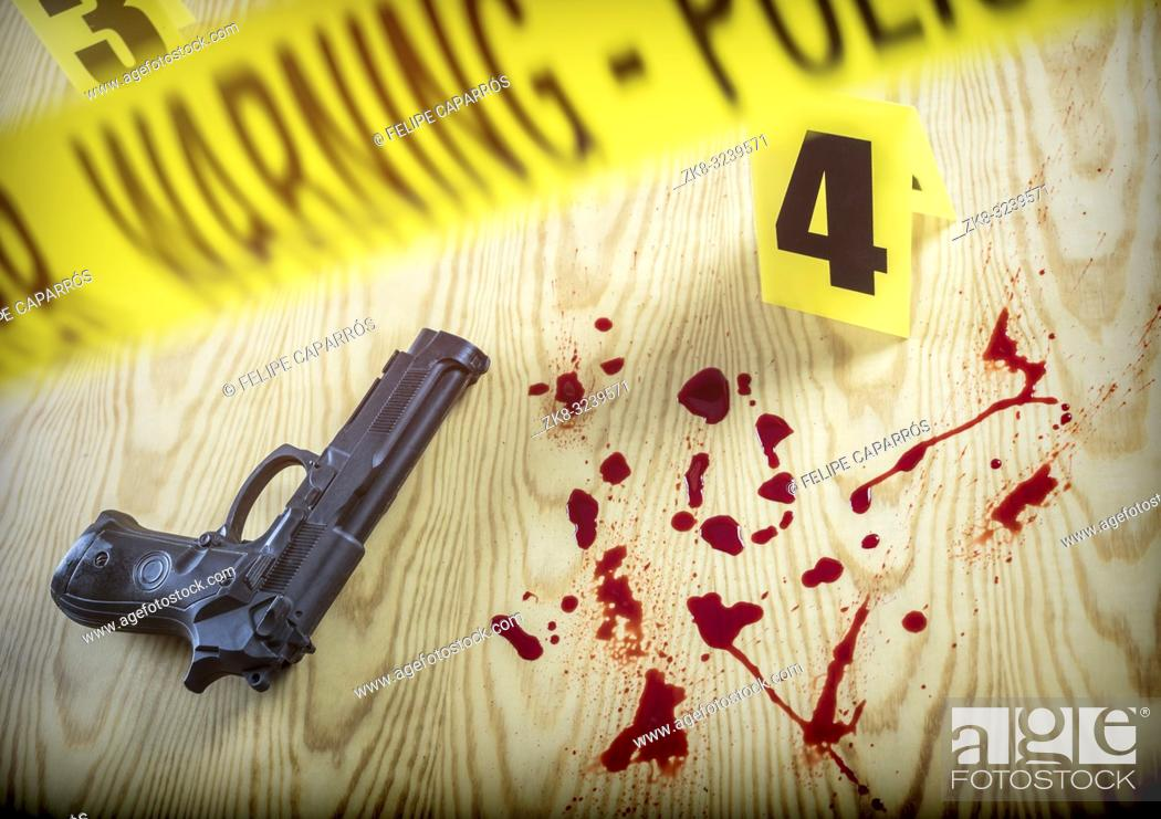 Stock Photo: scene of crime, Gun next to drops of blood on the ground, conceptual image, horizontal composition.