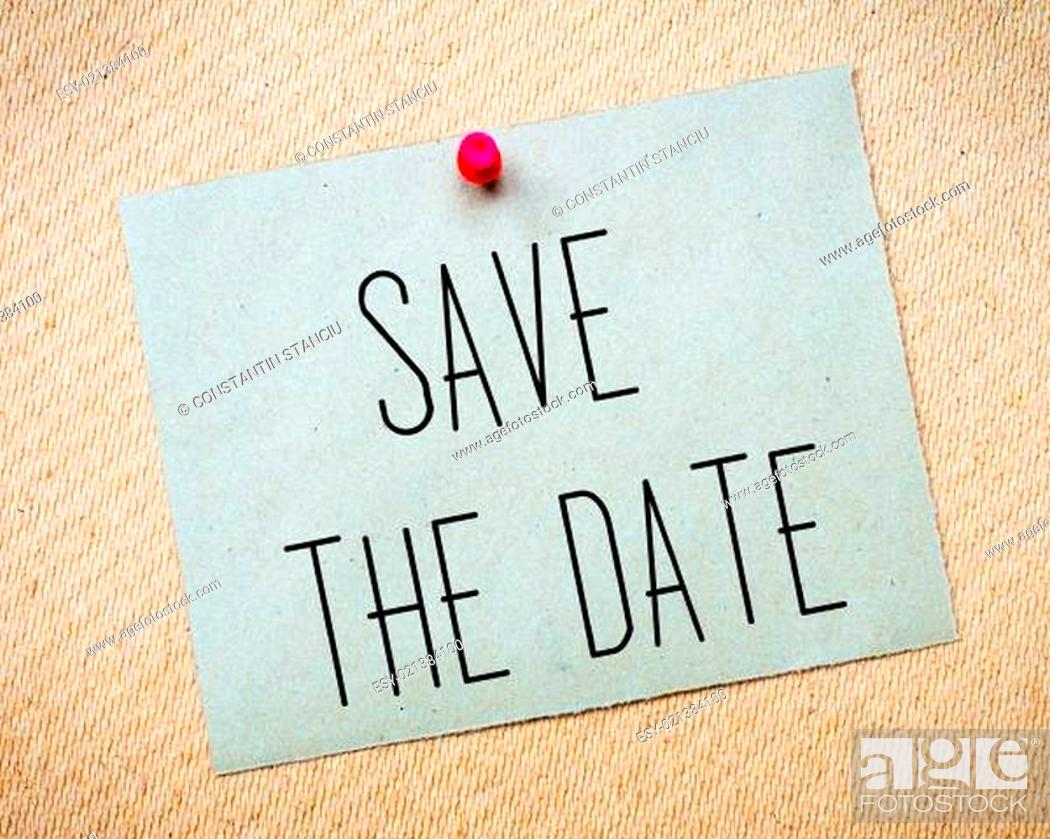 Stock Photo: Recycled paper note pinned on cork board.Save the Date Message. Wedding Concept Image.