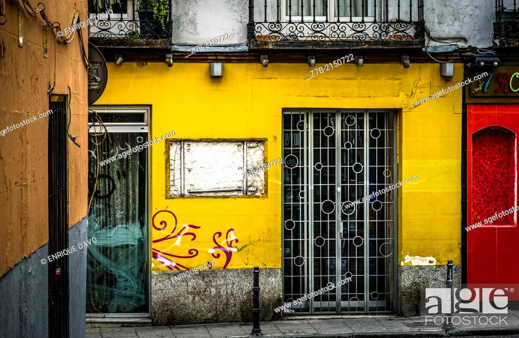Stock Photo: View of a yellow front in a central street of Madrid city, Spain.
