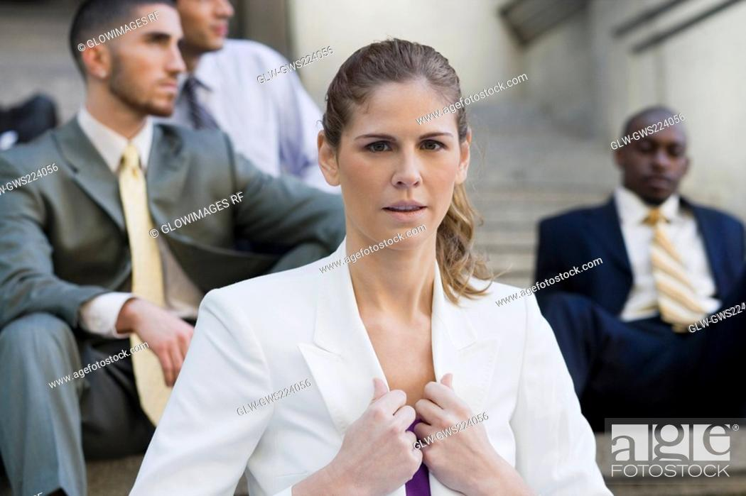 Stock Photo: Close-up of a businesswoman holding the lapel of her coat.