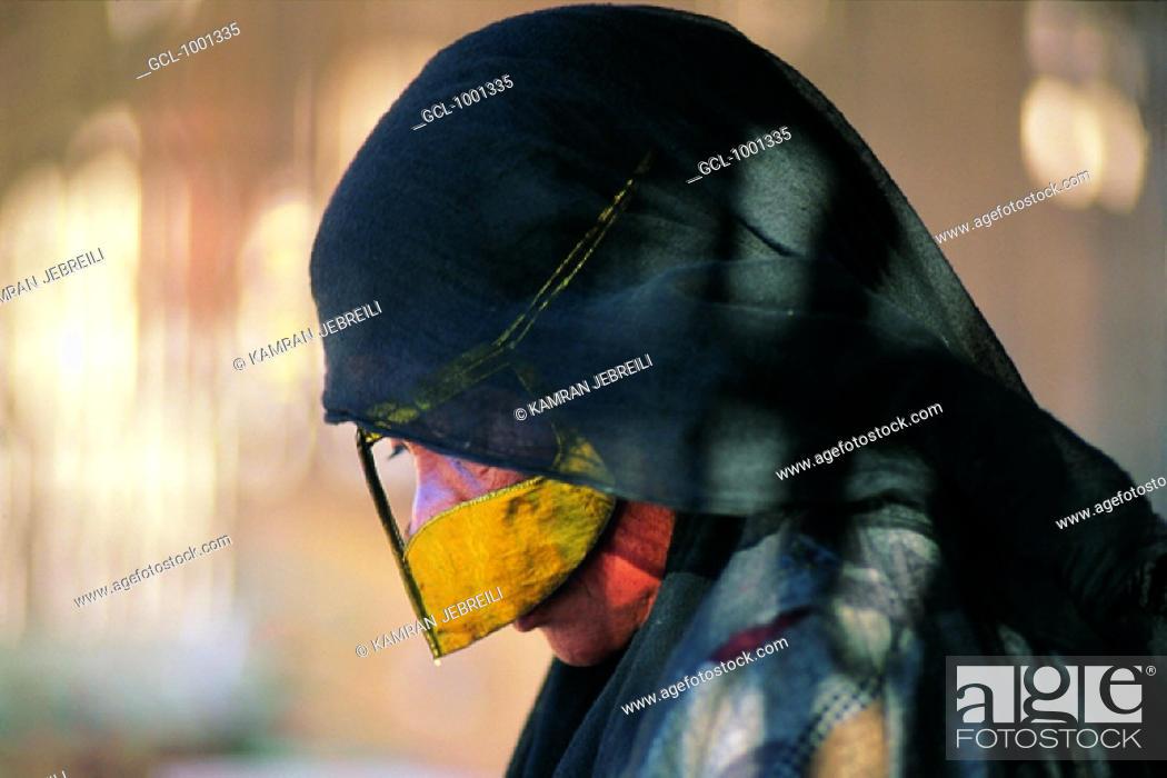 Stock Photo: Elderly Arab woman wearing a burqa, UAE.