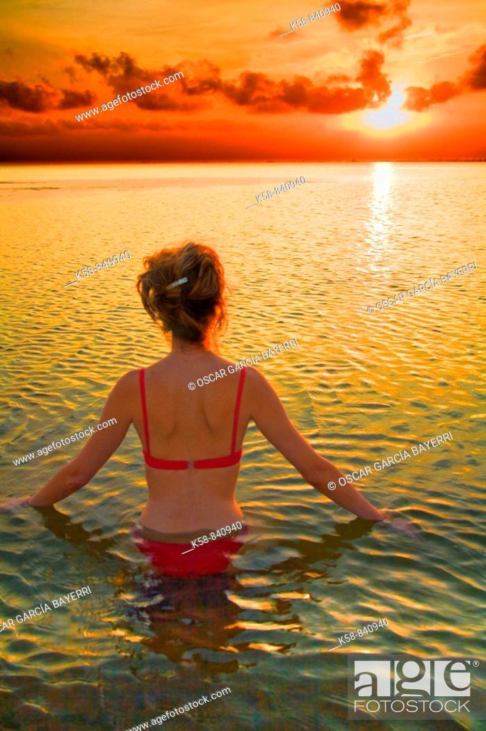 Stock Photo: Woman relaxing at sunset on the Costa Dorada, Tarragona, Spain.