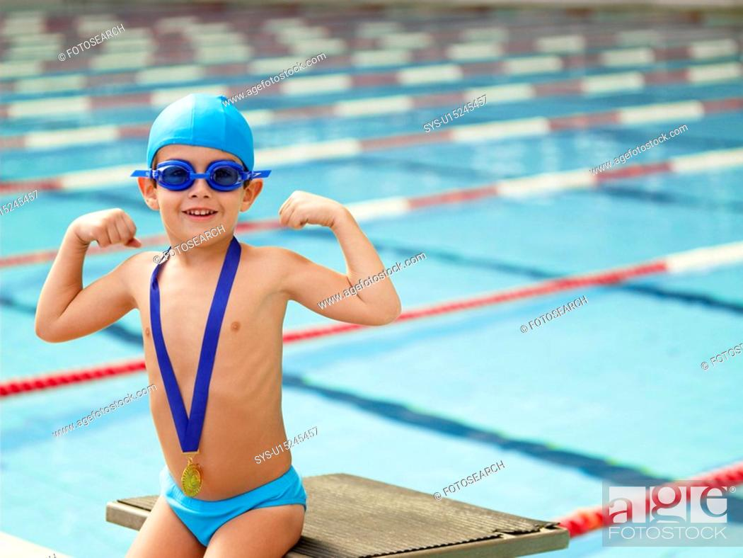 Stock Photo: Boy celebrating medal by swimming pool portrait.