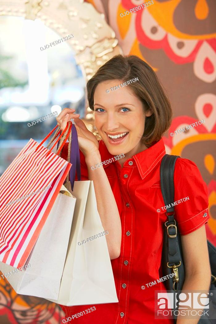 Stock Photo: Woman with shopping bags smiling.