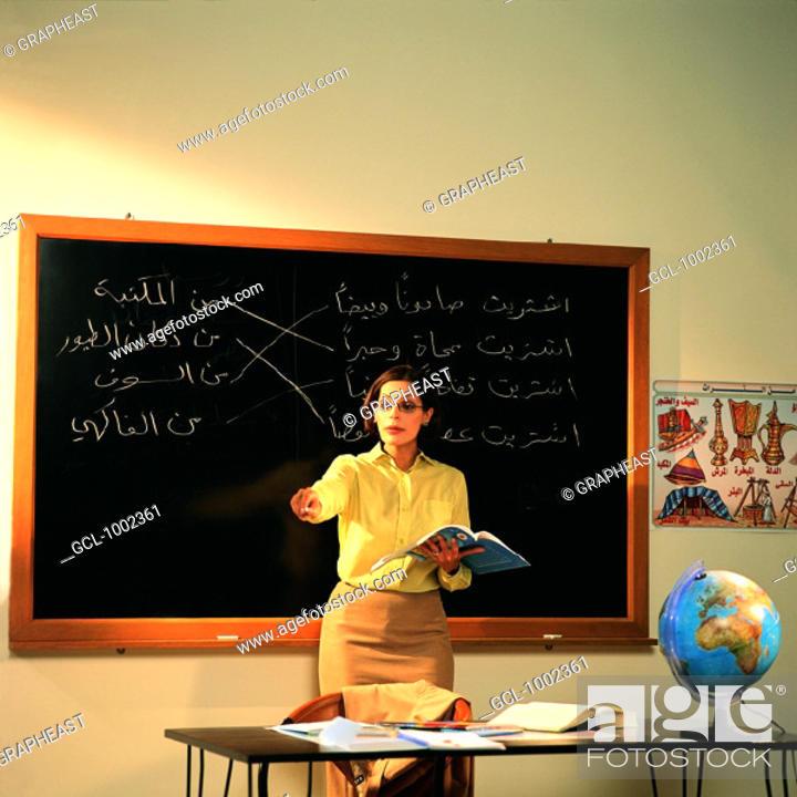 Stock Photo: Teacher in classroom.
