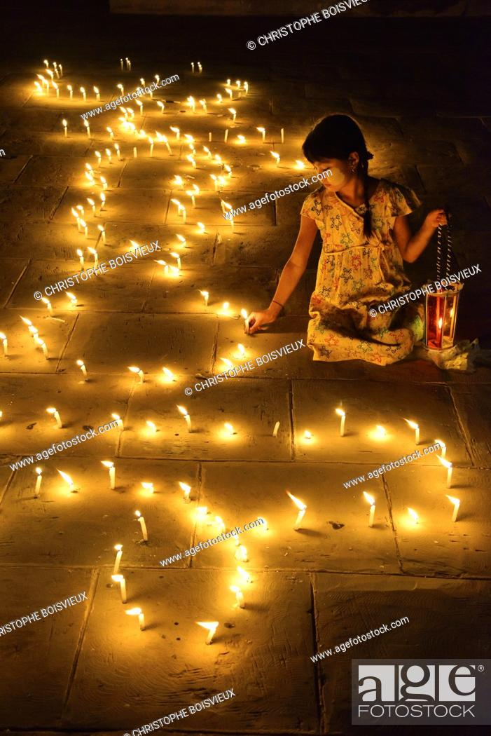 Stock Photo: Myanmar, Bagan, Ananda temple, Thadingyut festival of lights, Young girl lighting candles.