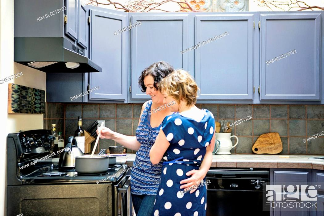 Free lesbians makes out while making spaghetti Lesbian Couple Cooking In Kitchen Stock Photo Picture And Royalty Free Image Pic Bim Bld218132 Agefotostock