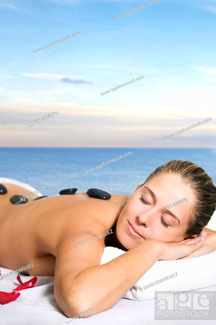 Stock Photo: Woman having a massage by the sea.