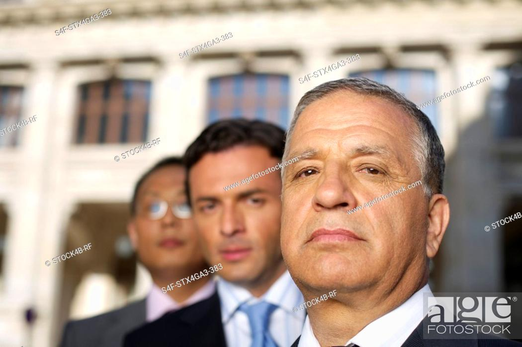 Stock Photo: Three Businessman in a row.