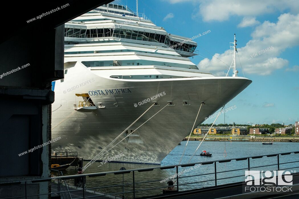 Stock Photo: Amsterdam, Netherlands. Cruise ship Costa Pacifica moored at Amsterdam Cruise Terminal during excursions of her passengers.