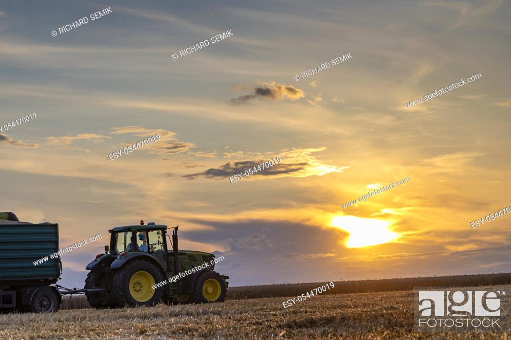 Stock Photo: Agricultural Season Harvest Time, Colorful Dramatic Sky At Sunset.