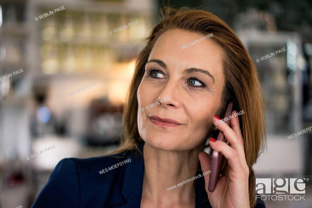 Stock Photo: Mature businesswoman talking on the phone.
