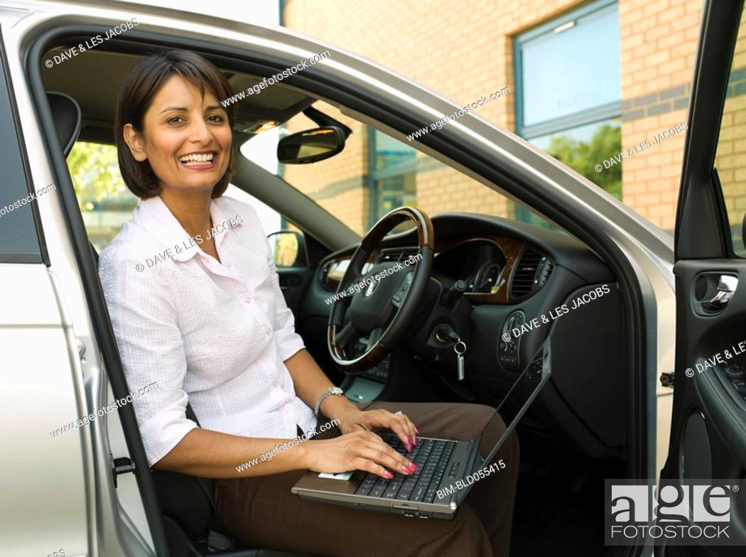 Stock Photo: Indian businesswoman typing on laptop.