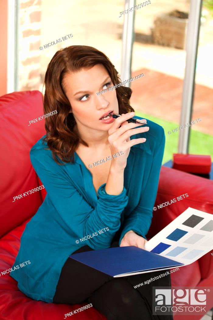 Stock Photo: Young woman holding color swatch.