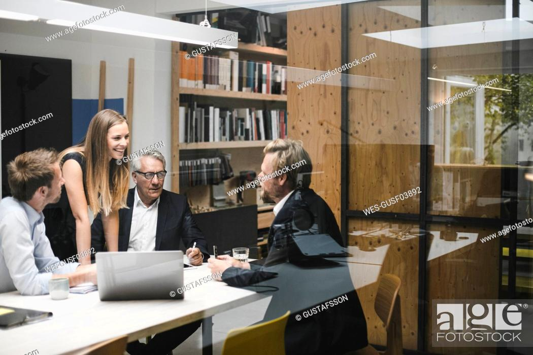 Stock Photo: Business people having a client meeting in office.