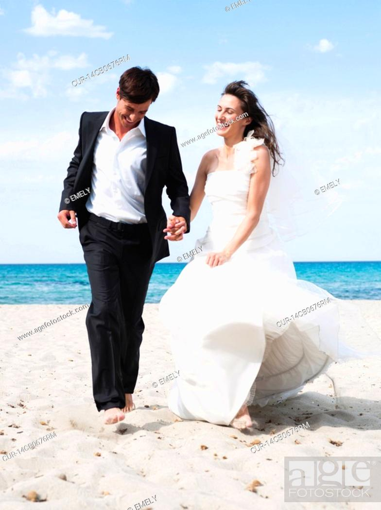 Swell Bride And Groom Running Along Beach Stock Photo Picture Download Free Architecture Designs Scobabritishbridgeorg
