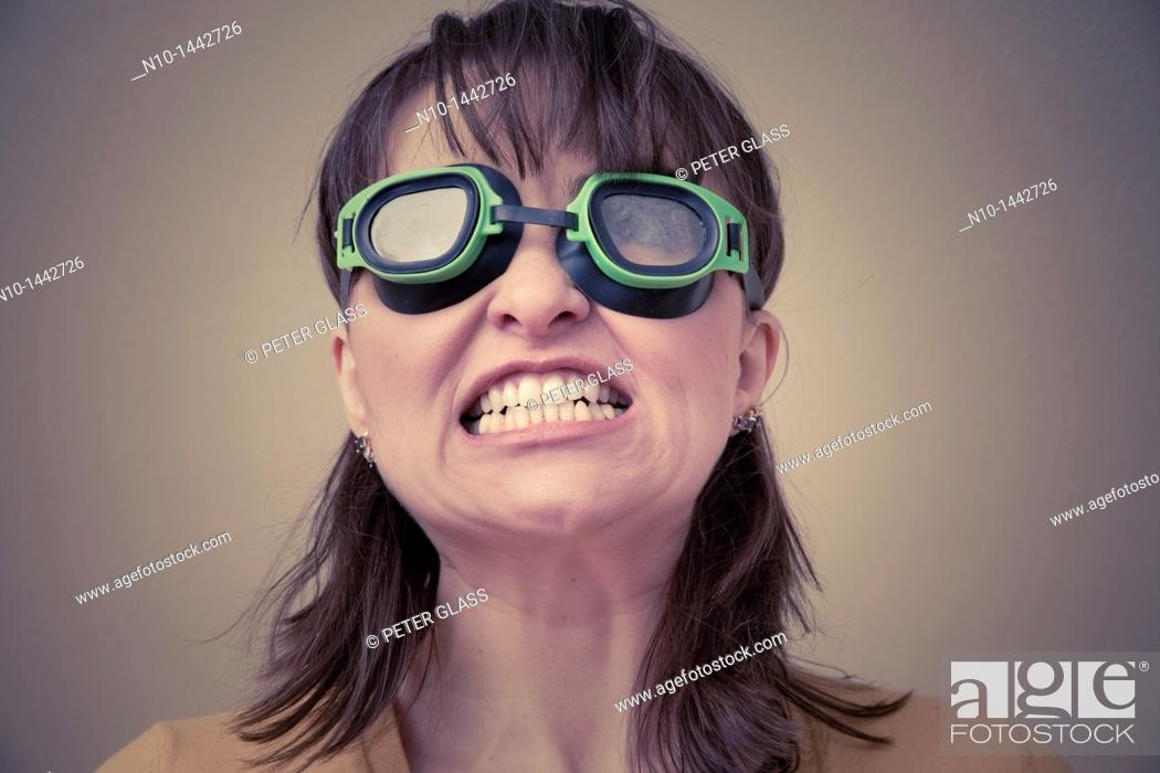Stock Photo: Young woman wearing goggles.