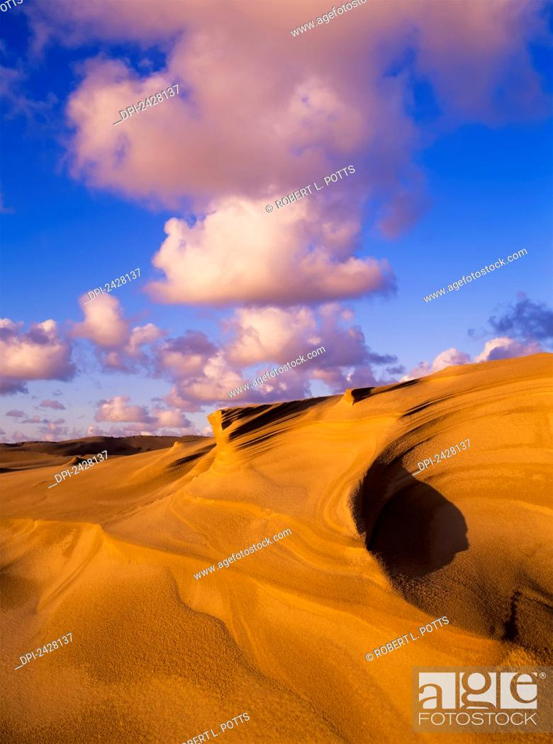 Stock Photo: Clouds and dunes are shape-shifters; Lakeside, Oregon, United States of America.