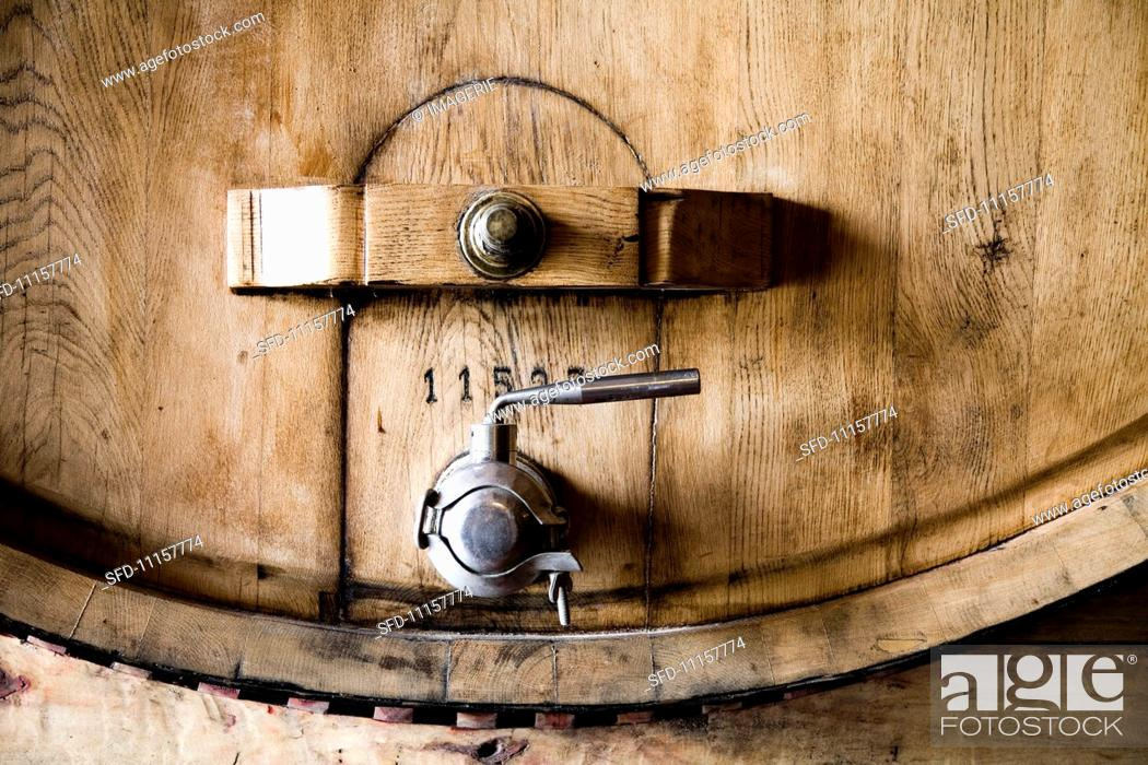Stock Photo: A wooden barrel with a metal tap.