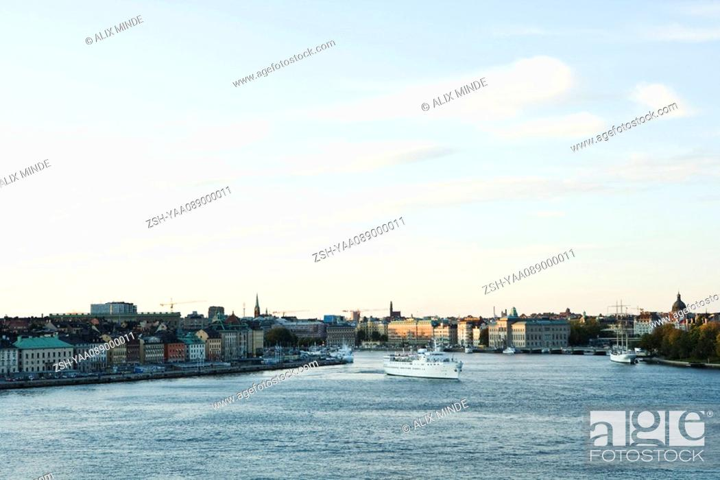 Stock Photo: Sweden, Sodermanland, Stockholm, cruise ship crossing canal.