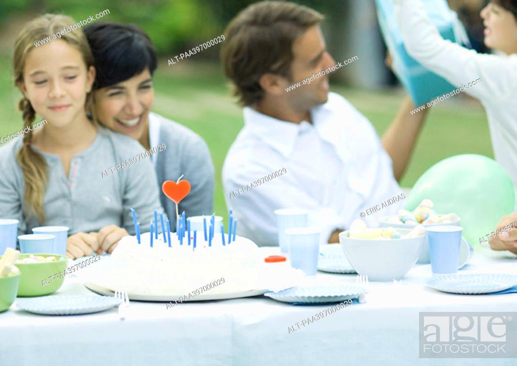Stock Photo: Family having outdoor birthday party.
