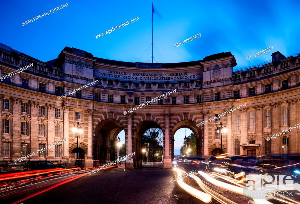 Stock Photo: Traffic light trails at Admiralty Arch at dusk, London, UK.