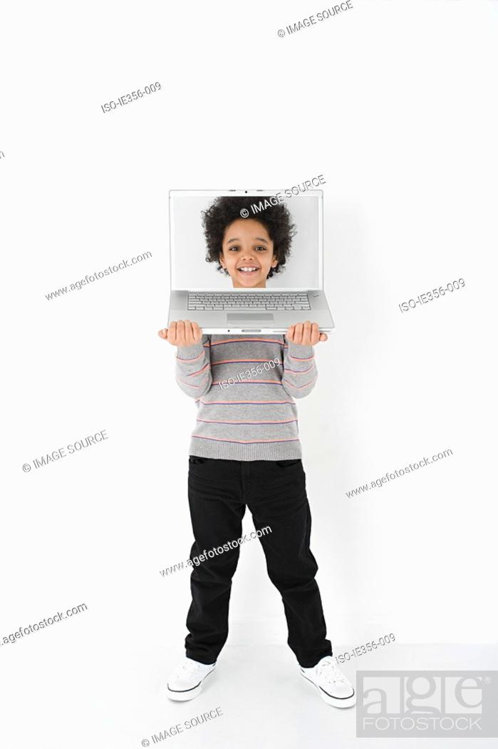 Stock Photo: Boy with face on laptop.
