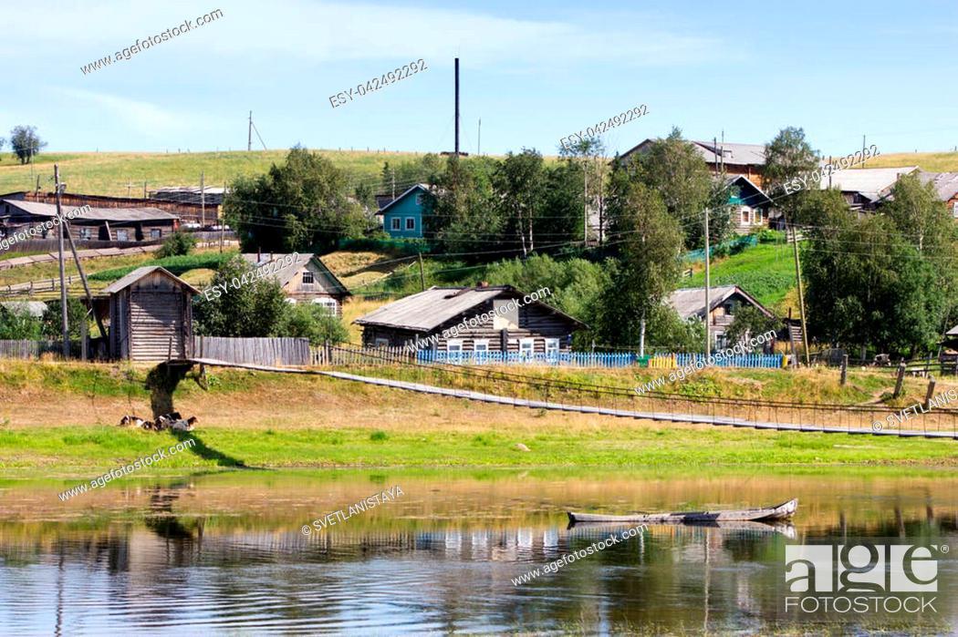 Stock Photo: Rural landscape of small village Zagrivochnaya near the river Pizhma.