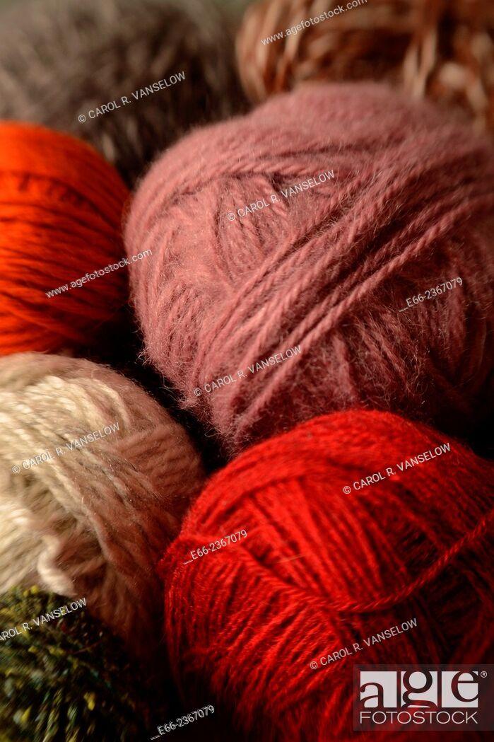 Stock Photo: Closeup shot of balls of yarn in various colours - orange, white, green, lavender, grey.