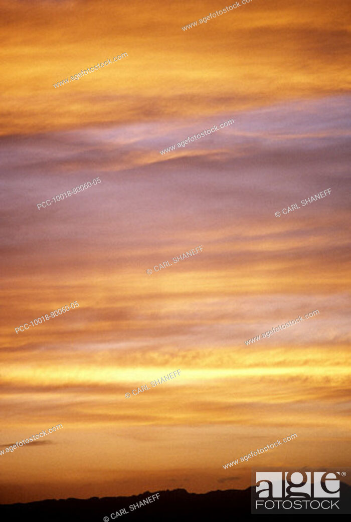 Stock Photo: Colorful cloudy sunset sky, yellow, pink and orange.
