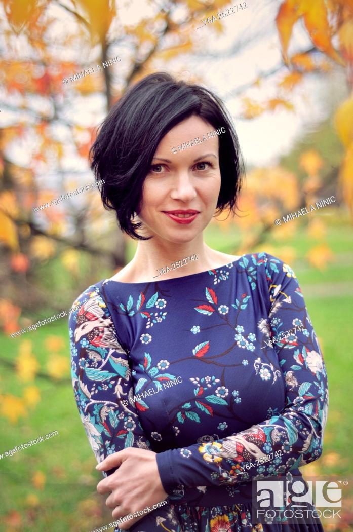 Stock Photo: Smiling mid adult woman portrait, autumn.
